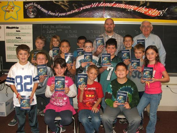 MICHAEL A. HEERY/SPECIAL TO THE TIMES NEWS Lehighton Rotary Club recently purchased and distributed dictionaries to every third grade student in both Lehighton and Palmerton Area School Districts. Pictured is Rotarian Rev. Leon Morgan (back row,…