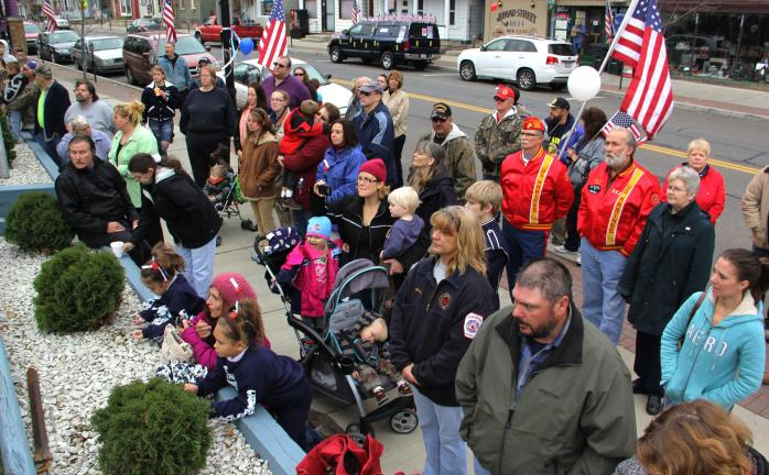 ANDREW LEIBENGUTH/TIMES NEWS Members and volunteers of the Tamaqua American Legion, Sons of the American Legion and Auxiliary members held a Veteran's Day program following the Tamaqua Veterans Day parade over the weekend. The program consisted of a…