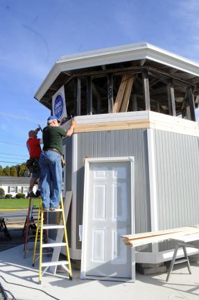 Gary Barkanic, back, and Keith Shelly, volunteers for the Lowe's Heroes program, make improvements to the historic judges' stand at the Lehighton Community Grove. The stand, possibly over 125 years old, was salvaged from the original Carbon County…