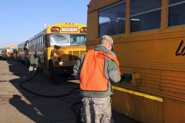 LARRY NEFF/SPECIAL TO THE TIMES NEWS A national guardsman fuels one of hundreds of school buses during operation Sandy.