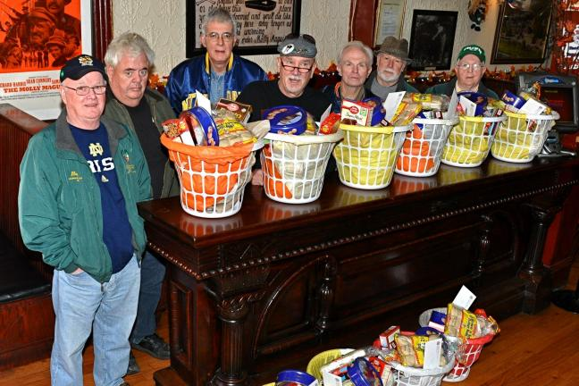 "VICTOR IZZO/SPECIAL TO THE TIMES NEWS Members of Jim Thorpe's AOH ""Alec Campbell, Mauch Chunk Division #1"" who helped prepare Thanksgiving Day food baskets last Saturday at Molly Maguires Pub & Steakhouse in JT are, left to right : Hugh…"
