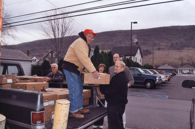Special to the TIMES NEWS Christian Action Council of Palmerton Area Churches (CACPAC) volunteers load turkeys and chickens to be distributed to Palmerton area clients for Thanksgiving. The Country Harvest Family Market donated all the turkeys and…