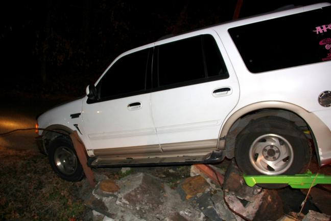 ANDREW LEIBENGUTH/TIMES NEWS A small concrete barrier and guard wire were all that prevented a large unoccupied SUV from careening into vehicles or homes around midnight Thanksgiving Eve in Tamaqua. Police were called to Elm Street after someone…