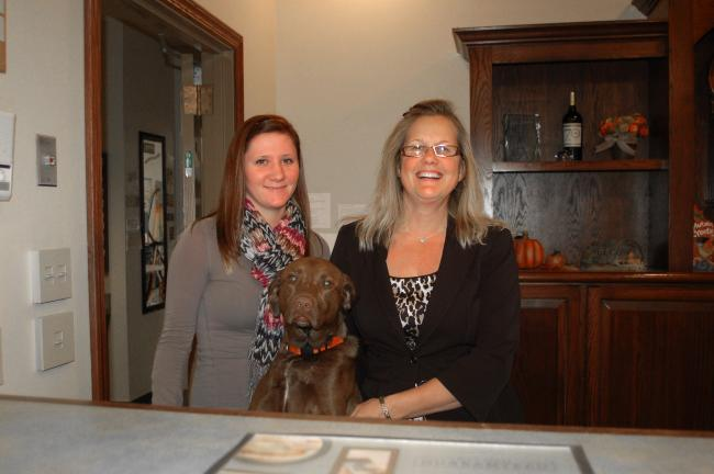 Gail Maholick/TIMES NEWS Country Inn and Suites, Lehighton, went the extra mile to help Hurricane Sandy survivors in the local area. From left are, Caitlin Swartz, front desk manager; and Roseann Lesher, general manager.