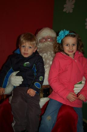 James Lazarchick, 2, of Waldorf, Md. and Holly Levitt, 6, of Stroudsburg, visit with Santa Claus at the Franklin Festival of Lights.