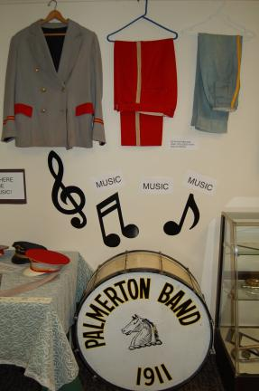 LINDA KOEHLER/TIMES NEWS Samples of the old gray and red band uniforms of the Palmerton Men's Band hand on display at the Palmerton Area Heritage Center.