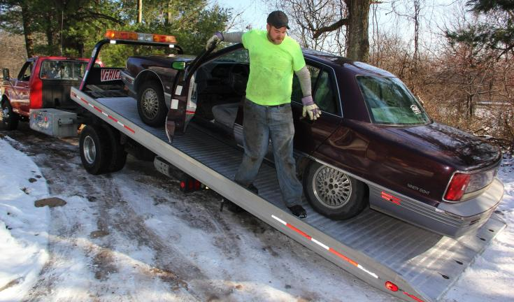 ANDREW LEIBENGUTH/TIMES NEWS Todd Gerber of Ziegler's Towing and Auto Repair donates his time helping a Kline Township family by picking and delivering the family's non-working car to the scrap yard. The family is hoping to receive another used car…