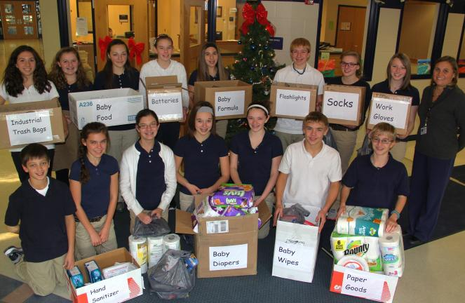 ANDREW LEIBENGUTH/TIMES NEWS Students and staff with Tamaqua Middle School's National Junior Honor Society collected and purchased items for storm victims of Hurricane Sandy. The students sold pencils and other items to raise funds as well. Teacher…