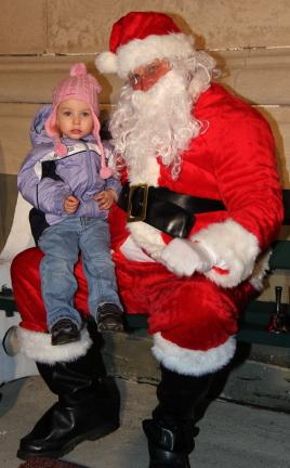 HARRY HONTZ/SPECIAL TO THE TIMES NEWS Adalyn Hontz sits on Santa's lap during his recent visit to Coaldale.