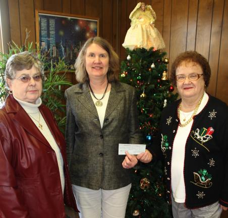 "ANDREW LEIBENGUTH/TIMES NEWS Members of the Alpha Theta Master of Beta Sigma Phi donated $250 to both the Tamaqua Area Public Library and Trinity United Church of Christ's ""Friends in Need"" food pantry. From left are Shirley A. Shamonsky, treasurer,…"