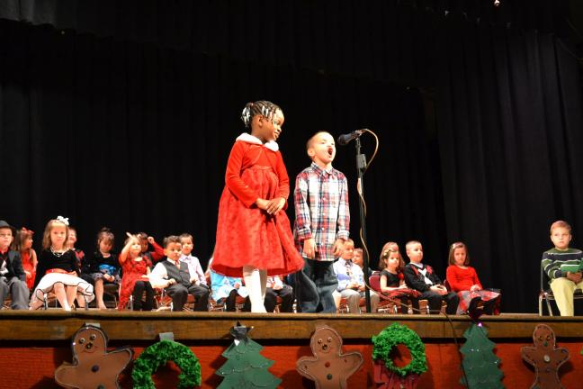 "@$:SHERI RYAN/SPECIAL TO THE TIMES NEWS Students Katrina Kirk and Brendan Ragin from the kindergarten class of Mrs. Jill Niehoff recites ""Christmas Dream"" during the annual Panther Valley Elementary School Kindergarten Holiday Program on Monday night."