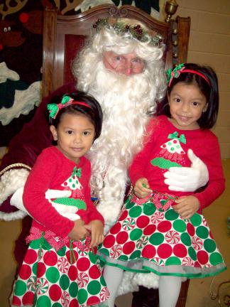 Lehighton Area Lioness Lions Club held its annual Breakfast with Santa. Sitting on Santa's lap were, from left, Bea, 4, and Yumi Santos, 5, daughters of Ernald and Patriz Santos of Pennsburg.