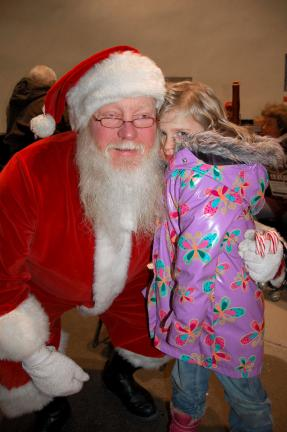 Emily Gombert spends a quiet moment with Santa Claus at the Christmas in the Park event held in Lehighton.