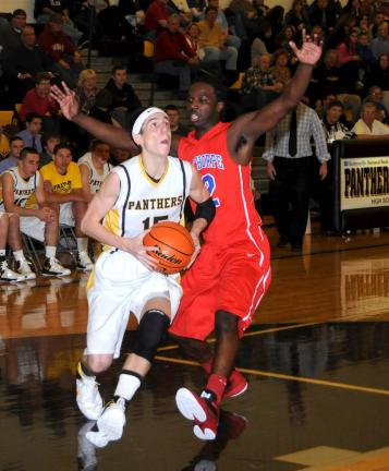 RON GOWER/TIMES NEWS Panther Valley's Steve Romanchik looks towards the hoop as Jim Thorpe's Jaquan Brown defends.