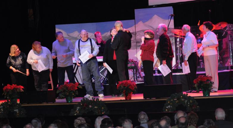 "Ron Gower/TIMES NEWS Audience members are called on stage and help the Lettermen sing ""The Twelve Days of Christmas"" during concert at Penn's Peak in Jim Thorpe, in what proved to be a hilarious segment of the show. Notice one woman gets up close…"
