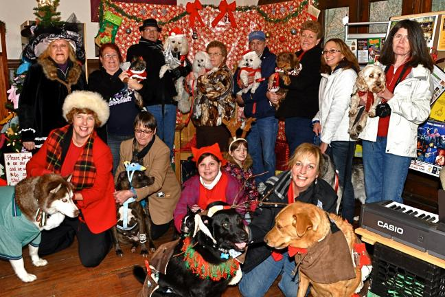 VICTOR IZZO/SPECIAL TO THE TIMES NEWS Pets and owners gathered for a group photo at the halfway point of their Costume Pet Parade around Jim Thorpe during the ongoing Olde Time Christmas celebration.
