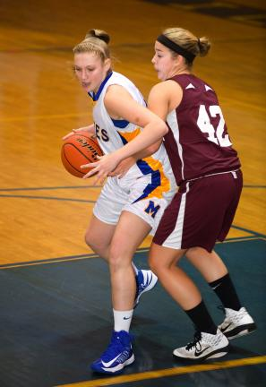 BOB FORD/TIMES NEWS Marian's Savanna Krsinsky looks to make a move to the hoop while Lehighton's Schyler Cordova defends.