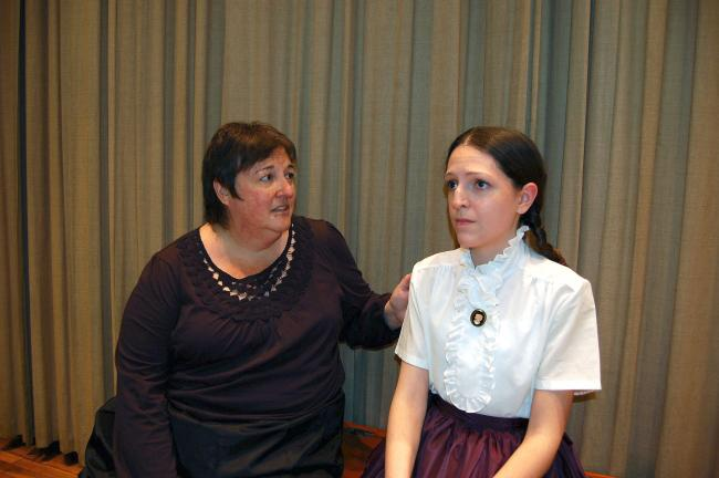 "ABOVE: Marmee (Michelle Stoudt) sings to Jo (Jessica Schafer) during a dress rehearsal for ""Little Women - The Musical.""  RIGHT: Rehearsing a party scene are cast members, from left, Shirley Rodgers, Jim Cimms, Caitlin Connolly, Marissa Miller and…"