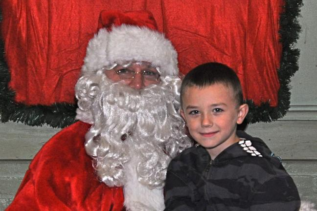 VICTOR IZZO/SPECIAL TO THE TIMES NEWS Six year old Jayden Cosalko, son of Jessica Mongi, enjoyed his time with Santa Claus at the Fairview Hose Company Social Club's Childrens' Christmas Party in JT.