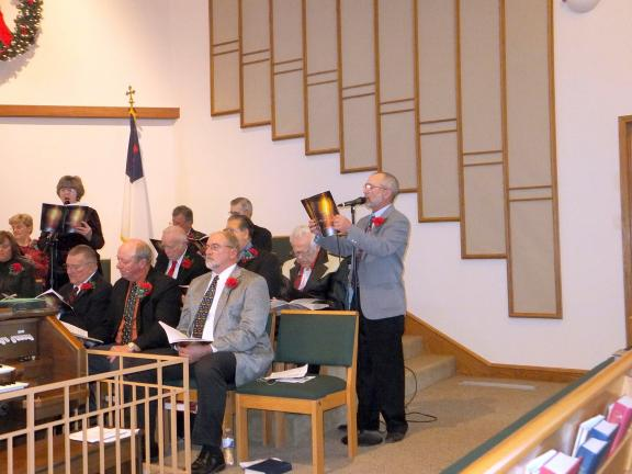 STACEY SOLT/SPECIAL TO THE TIMES NEWS Choir members Shirley Frantz, standing left, and Bob Keller perform a duet during the Ben Salem senior choir's annual Christmas cantata.