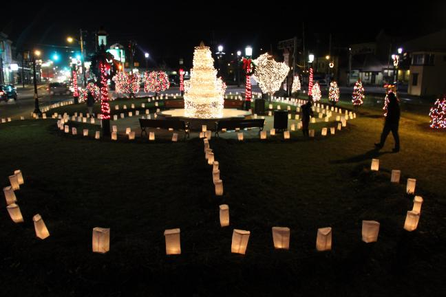 ANDREW LEIBENGUTH/TIMES NEWS The Depot Square Park in Tamaqua was surrounding by hundreds of luminaria candles Saturday night.
