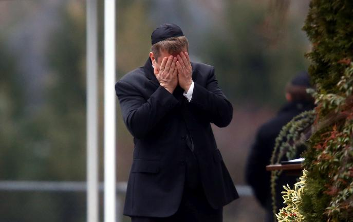 AP PHOTO A mourner arrives at the funeral service for 6-year-old Noah Pozner, Monday in Fairfield, Conn.