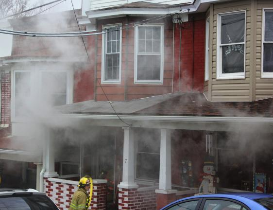 ANDREW LEIBENGUTH/TIMES NEWS A fire in the unit's block of North Walnut Street in Lansford yesterday resulted in two households being displaced.
