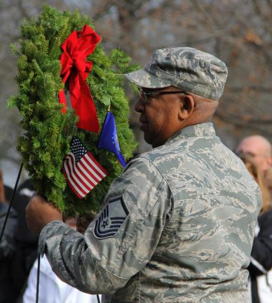 An airman lays a wreath during the start of the service.