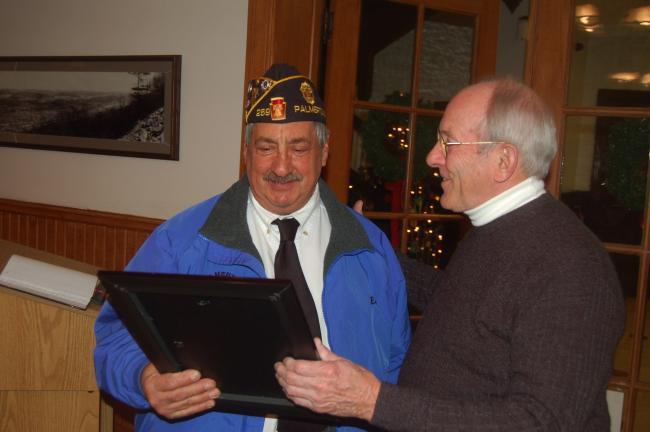 TERRY AHNER/TIMES NEWS Ed Moyer (left), commander of American Legion Post 269 of Palmerton, accepts a resolution from Palmerton Borough Council President Terry Costenbader (right) on Thursday. The resolution was to recognize the Palmerton Area…