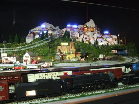 MICHAEL A. HEERY/SPECIAL TO THE TIMES NEWS Merchants Square Model Train Exhibit is now open to the public. The massive display features more than 40 HO, two-rail O, and three-rail O trains; 18,000 feet of track; and 30,000 lights illuminating…