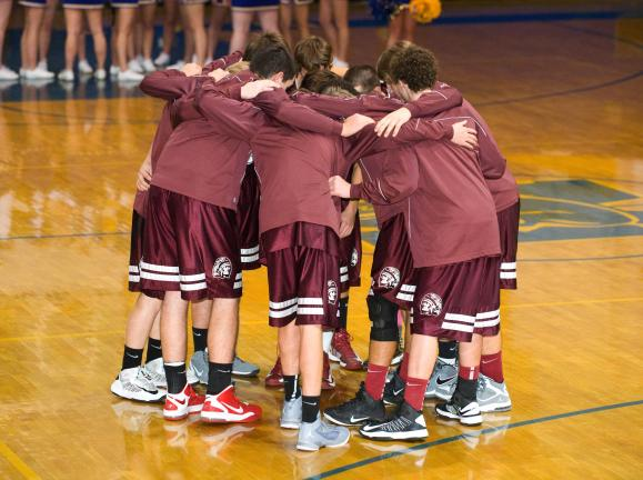 Bob Ford /times news The Indians huddle up before a game earlier this season against the Marian Colts. Lehighton is off to a solid start currently sitting at 4-3.