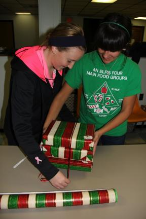Members and advisors with the St. Jerome's Catholic Church youth group in Tamaqua held their annual wrapping party to help the less fortunate over theholidays. 80 recipients,newborn to 16, from both Schuylkill and Carbon County benefited from the…