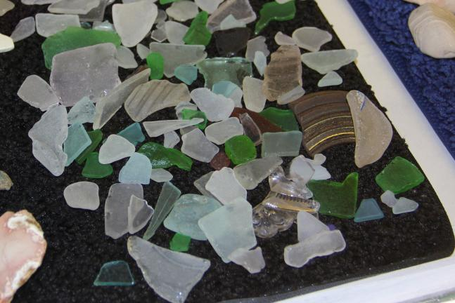 Pictured are smooth rocks and shards of glass Heath found along the borders of Lake Superior.