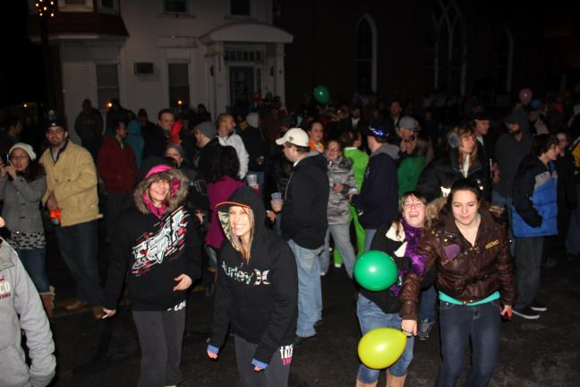 ANDREW LEIBENGUTH/TIMES NEWS A crowd of enthusiastic spectators filled the 200 block of East Broad Street during Tamaqua's New Year's Eve celebration.