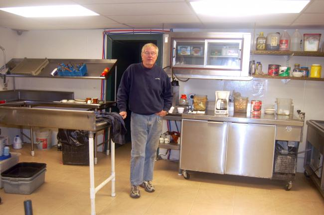 TERRY AHNER/TIMES NEWS Ron Gilbert, owner, Covered Bridge Inn, stands inside his new kitchen addition.