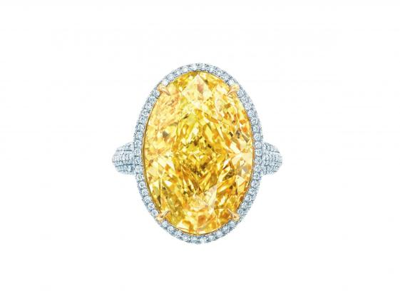 This image released by Tiffany's shows a 15.04ct Oval Fancy Vivid Yellow Diamond Ring with white diamonds and set in platinum and 18k yellow gold. (AP Photo/Tiffany's)