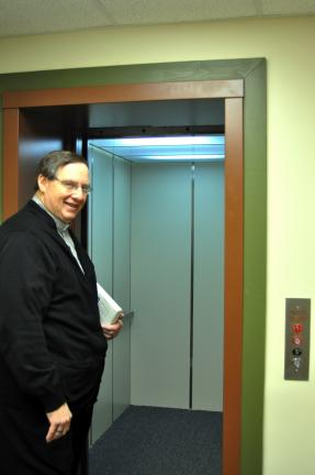 DONALD R. SERFASS/TIMES NEWS The Rev. James Cavallero provides a tour Tuesday of the new elevator at First United Methodist Church, 124 W. Broad St., Tamaqua.