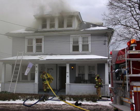 ANDREW LEIBENGUTH/TIMES NEWS Firefighters were quick to quell a duplex fire yesterday in Packer Township. Two families, including a 5-day-old baby boy, were displaced by the fire.