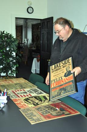 History enthusiast Dale Freudenberger, Tamaqua, sorts through his private collection of posters from Lakeside Park in preparation for a potential museum display in tribute to the legendary Barnesville site.