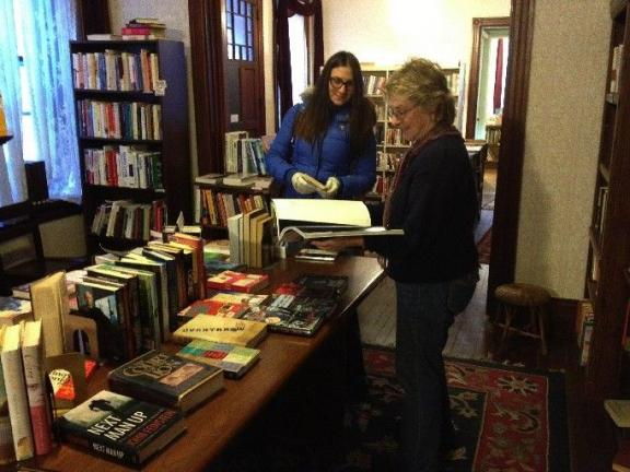 "AL ZAGOFSKY/SPECIAL TO THE TIMES NEWS Janet Hermann, president of the Friends of the Dimmick Memorial Library (right) talks with Veronika Sostak, a visitor on a getaway from New York City. ""I saw the sign 'Book Sale Today'. I love books so I came in…"