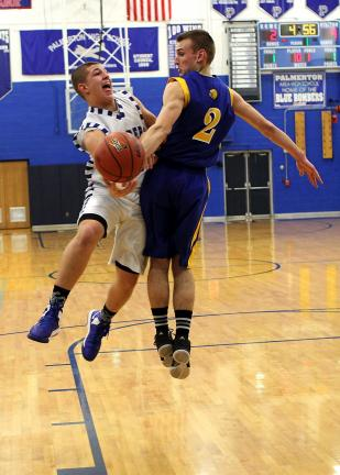 rich George/special to the times news Palmerton's Logan Lesher (left) glides around Wilson's Mike Chorazak to get off a shot.