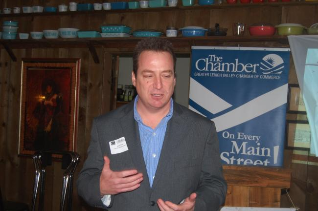 TERRY AHNER/TIMES NEWS Gary Frey, certified public accountant, Frey & Co. CPA's, Walnutport, discusses tax law changes at a recent joint luncheon between the Palmerton Area Chamber of Commerce and Greater Northern Lehigh Chamber of Commerce.