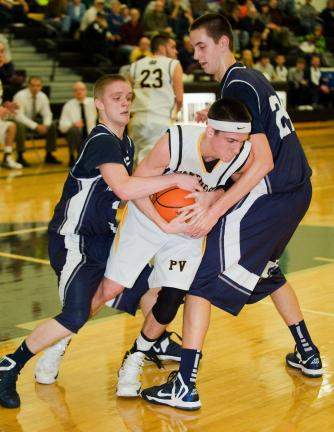 bob ford/times news Panther Valley's Steve Romanchik is tied up by Tamaqua defenders Drew Chartier (left) and Brett Kosciolek (24).