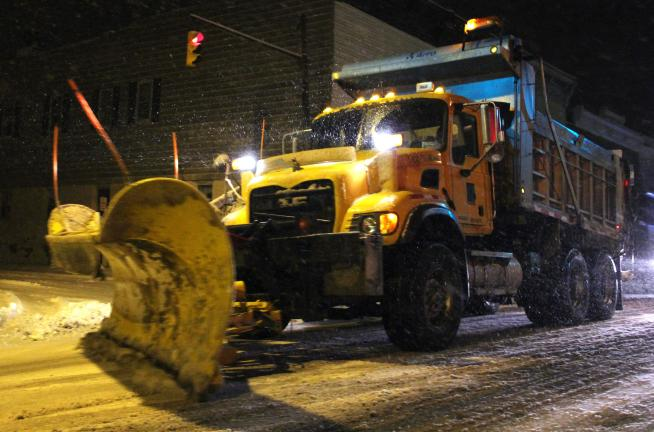 ANDREW LEIBENGUTH/TIMES NEWS Both municipal road crews and PennDOT crews worked from night to morning as they laid salt, cleared intersections and plowed roads. A PennDOT plow removes snow from Kennedy Drive (SR309) in McAdoo.