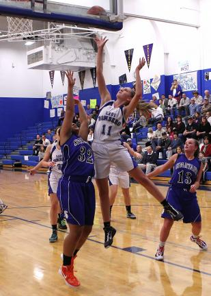 RICH GEORGE/Special to THE TIMES NEWS Palmerton's Madison Mummey (11) goes up for a shot as Southern Lehigh's Brianna Prince (32) defends. The Spartans' Kati Yext (13) looks on at right.