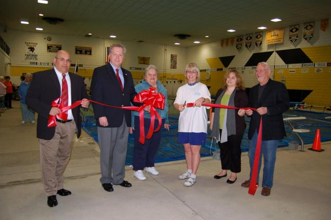 TIMES NEWS FILE PHOTO In March, local officials cut a ribbon marking the opening of Water Wellness at the Panther Valley High School swimming pool. From left are Bill Richardson, a representative for Sen. John Yudichak; Lansford Alive President Mark…