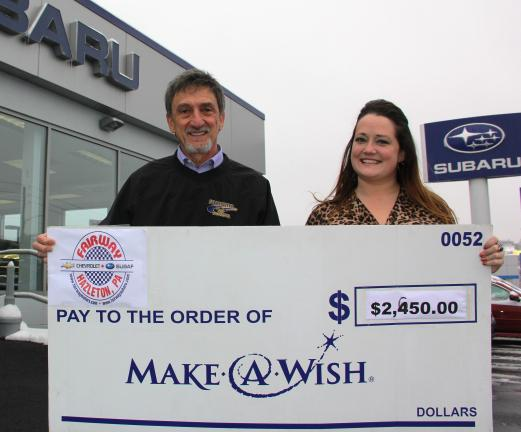 ANDREW LEIBENGUTH/TIMES NEWS Make-A-Wish Regional Manager Maggie O'Brien accepts the donation from Fairway Subaru Marketing Manager Richie Molinaro.