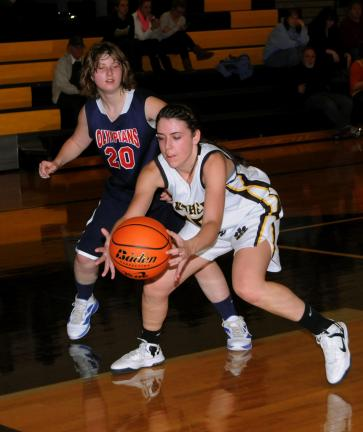 ron gower/times news Kailee Smith (right) of Panther Valley reaches to get a loose ball as Jim Thorpe's Alissa Rusbarsky (20) moves in from behind.