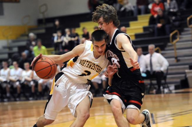 Nancy Scholz/TIMES NEWS Northwestern's David Wagner tries to drive past Keith Mosher of Saucon Valley during Friday's Colonial League game.
