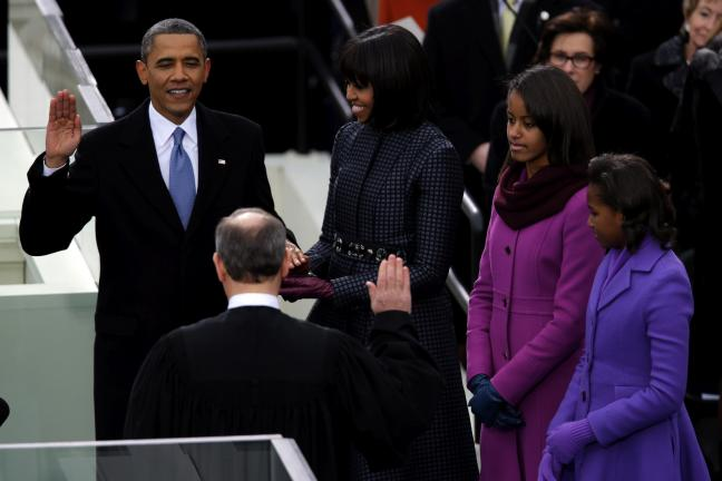 AP PHOTO President Barack Obama receives the oath of office from Chief Justice John Roberts as first lady Michelle Obama, center, and daughters Malia and Sasha listen at the ceremonial swearing-in at the U.S. Capitol during the 57th Presidential…